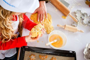 Family baking Christmas cookies in kitchen