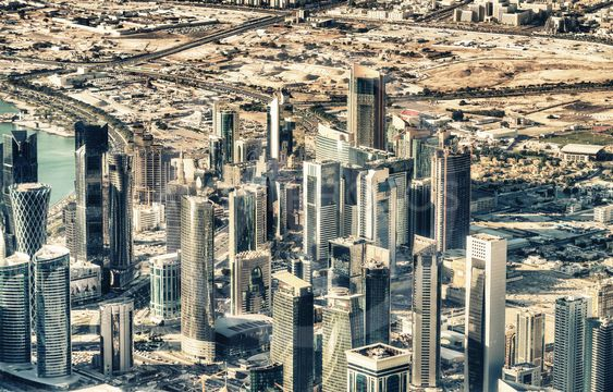 Doha aerial skyline from the airplane. Doha is a major...