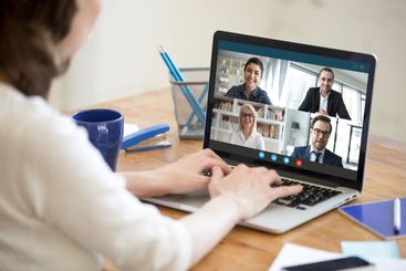 Woman working from home participating in group video call