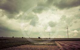 dark clouds over fields