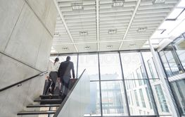 Business people on a stair in the office building