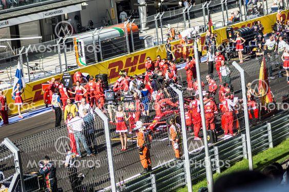 The Scuderia Ferrari team on the grid.