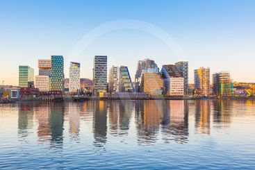 Modern buildings in Oslo with their reflection into the...