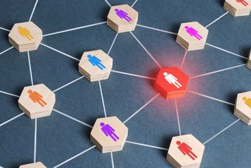 Red human figure in a network. Cooperation,...