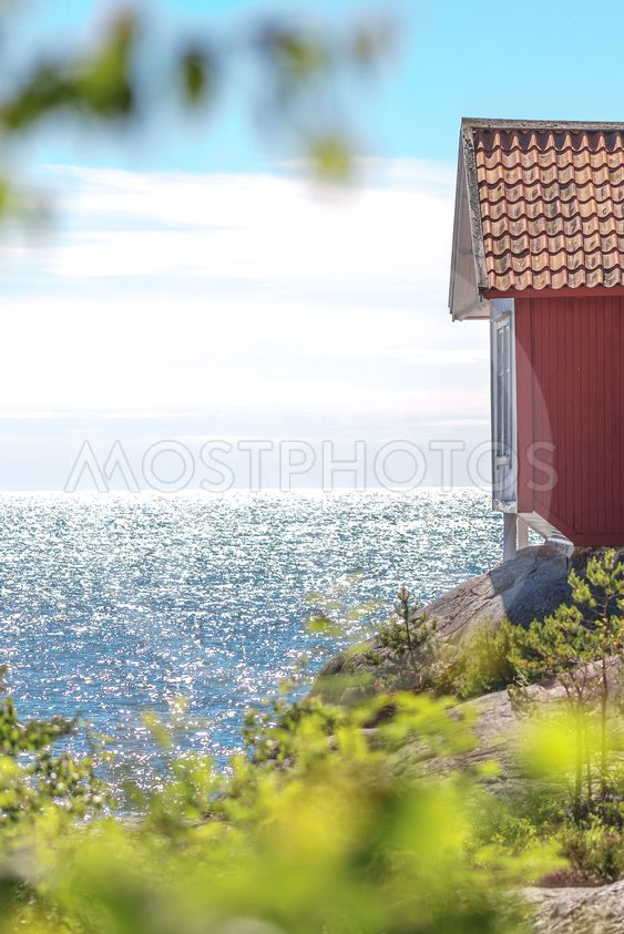 The writing Albert Engstrom writing cabin at the shore of...