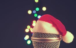 Close up of a microphone with the hat of Santa and...