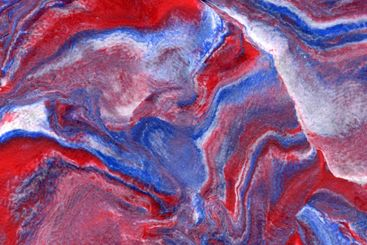 Mixed red white and blue plasticine abstract background.