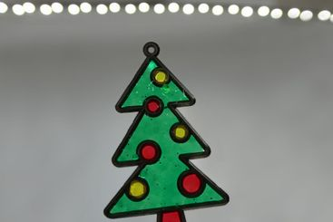 Crafted stained glass Christmas tree close up