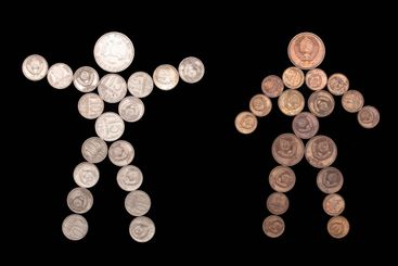 man and woman silhouette of coins