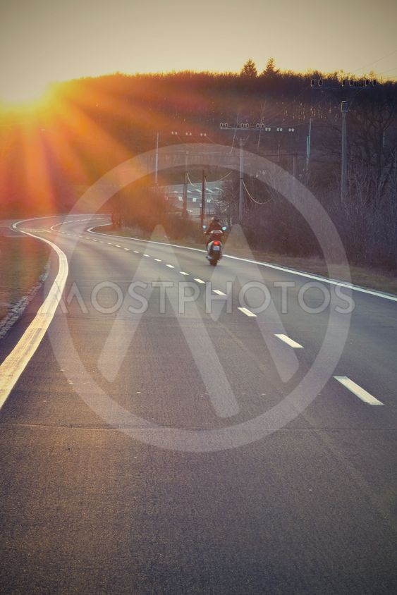 Sunset Highway with scooter / motorcycle