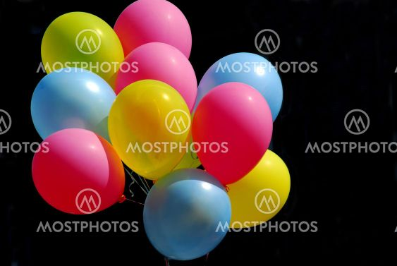 Colorful balloons on black