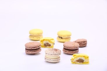 Colorful whole macaroons and piece with stuffing...