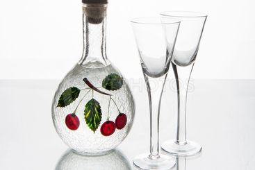 Two glasses and a bottle