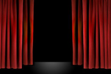 Elegant theater stage with red velvet curtains
