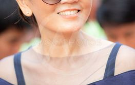 toothy smiling face of beautiful asian woman happiness...