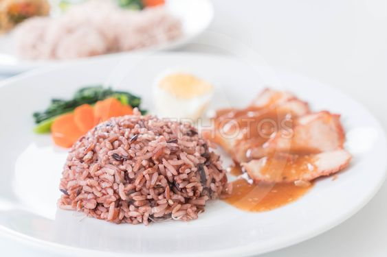 Barbecued red pork in sauce with berry rice