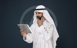 Arabian saudi businessman on dark blue studio background