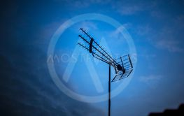 Arial antenna searching for signal during the evening