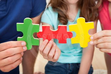 Family Joining Puzzle Pieces