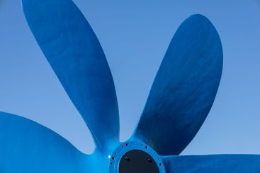 Large boat propeller painted blue