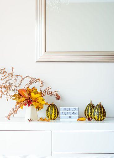 Box with text HELLO AUTUMN, decorative striped pumpkins...