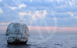 old sea buoy in the sea