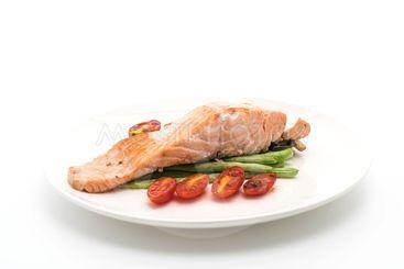 grilled salmon steak on white