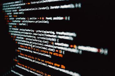 Horizontal shot of some programming code written in...
