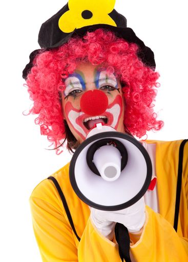 Funny clown with a megaphone