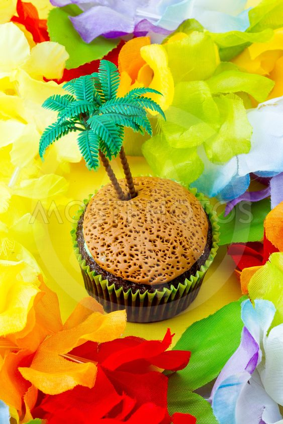 close up image of cupcake with plastic coconut tree...