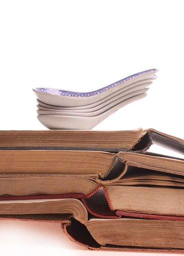 Chinese spoons on a pile of old prescription-books