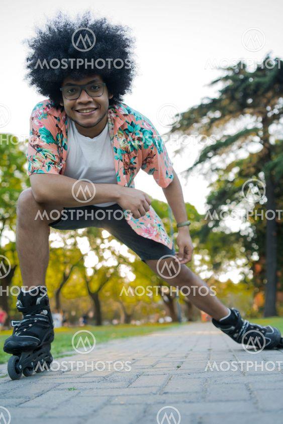 Afro Latin man rollerskating outdoors.