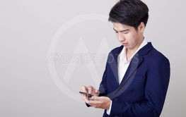 Young asian businessman using a smart phone