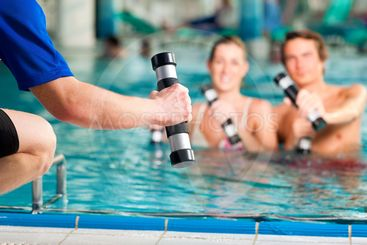 Fitness - sports and gymnastics under water in swimming...