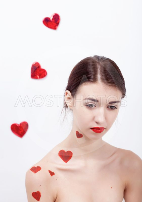 Brunette girl with red hearts