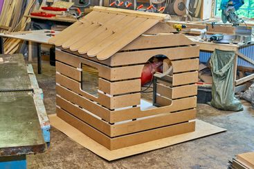 Kids play house in workshop during manufacturing process