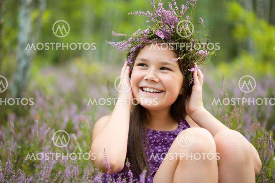 Happy girl is wearing heather wreath