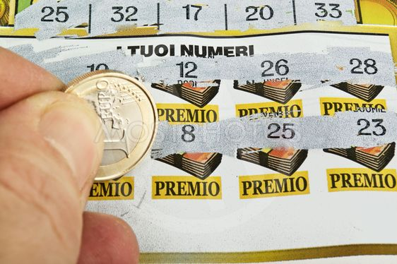 a  human hand is scratching a lottery ticket