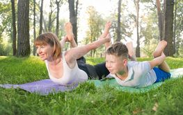 Portrait of 12 years old boy doing yoga exercise with...