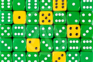 Background of random ordered green dices with six yellow...