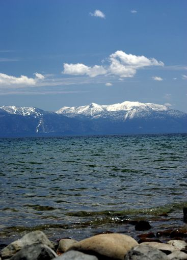 Lake Tahoe And Snow Covered Mountains
