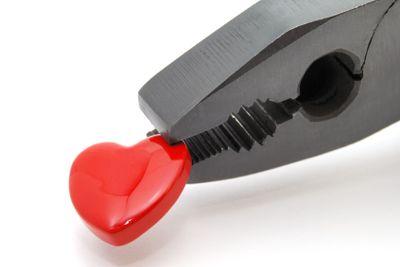 Heart in black pliers