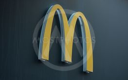 Mc Donald's logo on fast food entry in the street
