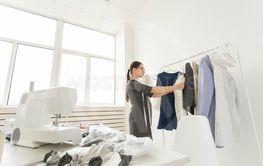 Dressmaker, fashion designer and tailor concept -...