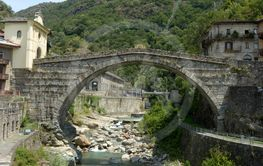 Overview of the ancient Roman bridge at sunset in the...