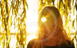 Autumn portrait of young happy smiling girl with flying...