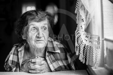Close-up black and white portrait of an elderly woman.