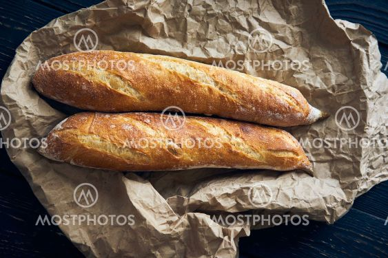 Homemade baguette bread on dark wooden table