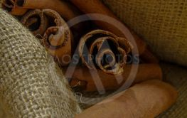 Cinnamon sticks on the burlap cloth