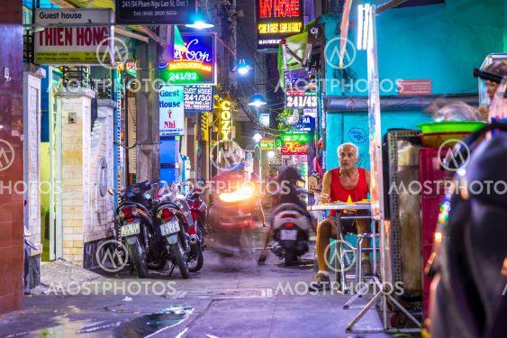 Nightly street scene of a side street in Ho Chi Minh City